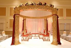 Indian Wedding Planner Book Classic Gold Jali Mandap With Beautiful Gold And Red Drapes