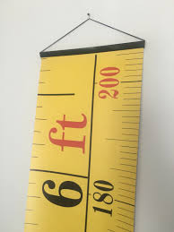 yellow tape measure hanging height chart imperial u0026 metric height