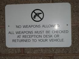 check in desk sign please check your gun at the door rubber tr artist