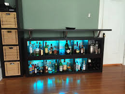 australian simple kitchen with black wooden liquor cabinet wine
