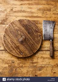 butcher meat cleaver and chopping board block on wooden background butcher meat cleaver and chopping board block on wooden background