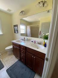 how to clean wood cabinets in bathroom how to paint your bathroom cabinets your abode
