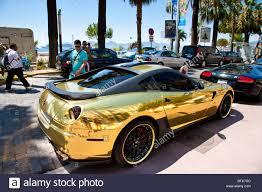 car ferrari gold gold ferrari parked outside the carlton hotel cannes cote d u0027azur