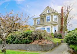 spring landscape with classic american craftsman style home stock