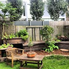 cozy small backyard landscaping house design with wooden fence