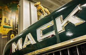 gold bulldog ornament on a 1986 mack roll truck at waste