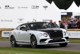 the motoring world goodwood bentley watch supercars go flat out up goodwood hill iol motoring