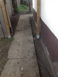 sidewalk sloping towards house suggestions
