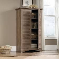 sauder harbor view bookcase with doors antique white harbor view storage cabinet the brick