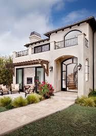 spanish home designs mediterranean exterior cream deep gray red roof light fixtures