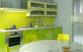 chic green kitchen with mosaic backsplash tile also laminate wood