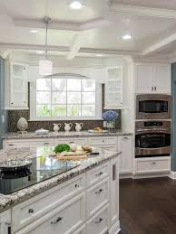 kitchen with white cabinets and induction cooktop buying guide