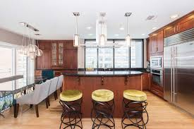 come home to modern luxury in paulus hook at this spacious triplex