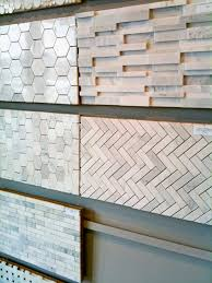 behind the range backsplash chevrons but pointing up and down