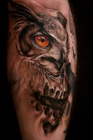 grey owl and rose tattoos on upper arm