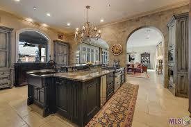 mediterranean kitchen with kitchen island u0026 limestone tile floors