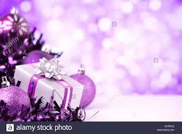 purple and silver baubles and a gift in front of