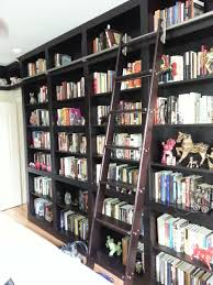Rolling Ladder Bookcase Built In Bookcases With Rolling Ladder And Hidden Vault