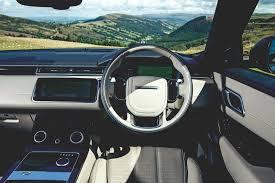 new land rover velar interior range rover velar vs porsche cayenne vs audi q7 luxury suv mega