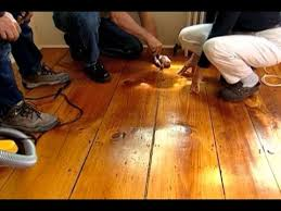 how to fill gaps in a wide plank wood floor this house
