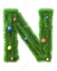 n letter made of christmas tree branches isolated on white
