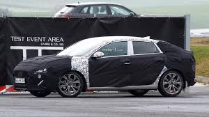 hyundai i30 fastback spied trying to hide its stylish rear