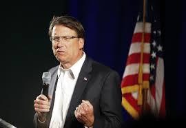 n c governor signs bill repealing charlotte transgender bathroom law
