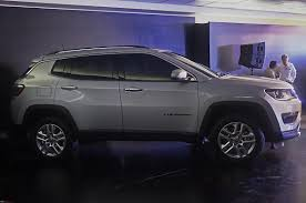dark grey jeep meeting the jeep compass edit priced between 14 95 to 20 65