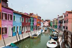 colorful houses and canals of burano island italy stock photo