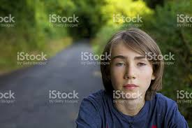 12 year old boy with long hair from book infestation long haired 13 year old boy looking at the camera stock photo