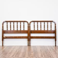 this jenny lind bed frame is featured in a solid wood with a