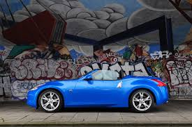 blue nissan 370z nissan 370z roadster review 2010 2014 parkers