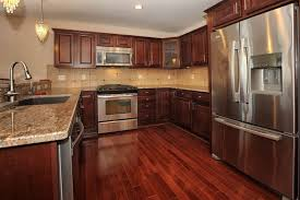 kitchen cabinet red cabinets floors white granite countertop
