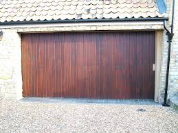 garage door opens by itself round the corner garage doors