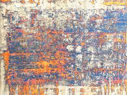 all about j d staron s new collection of abstract rugs new york e 16 reds and yellows contrasts the light and dark of the pre dusk