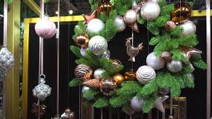 wreath decorated with balls and a figure of a