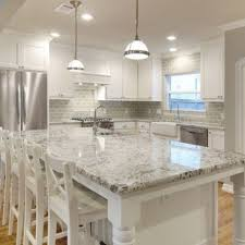 sunshiny white kitchen cabinets with granite counter tops