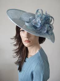 cornflower blue wavy sinamay hat from dress 2 impress hat hire
