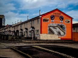 12 of the best cities for street art in europe eternal arrival street art in belfast ireland