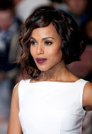test out a trendy asymmetrical bob by sweeping curly hair into a