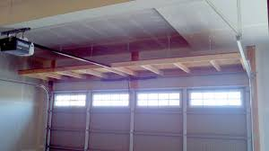hanging shelves above garage door storage pinterest shelves