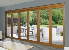 Glass Folding Patio Doors Patio Glass Folding Patio Doors With White Patio Table And