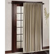 long cream curtain on the black pole for glass door having brown