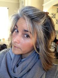 blonde streaks for greying hair nine months of grow out salt pepper roots blending with blonde