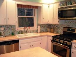 small l shaped kitchen layouts blue highlighted modern electronic