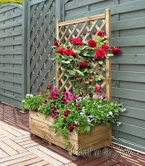 wooden garden flower planter with trellis for climbing plant