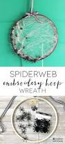how to make a spider web for halloween make this simple halloween spiderweb wreath with a wooden