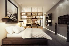 interior integrated bedroom and kitchen divided by bookcase