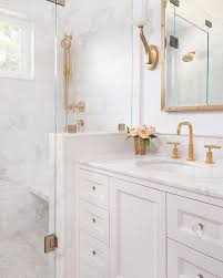 Gold Bathroom Fixtures A White Bathroom Creates The Palate For Fixtures To Really