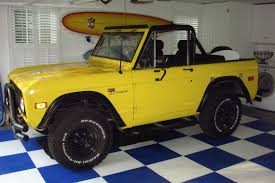 yellow jeep on beach custom traditional homes dutch colonial shingle style